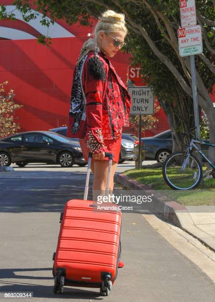 Erica Moore travels in style with a Rockland suitcase and her Vampire Rockstar jacket at New Faces at TAP The Artists Project on October 18 2017 in...