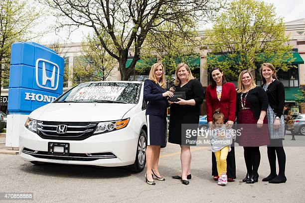 Erica Nicole Weber Honda District Sales Manager for Automobile Sales presents the keys to a new 2015 Honda Odyssey minivan to Karen Torres Executive...