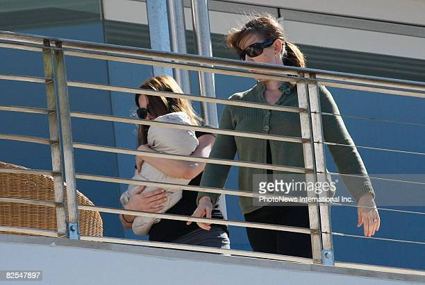 Erica Packer holds her new daughter Indigo born to her and husband James Packer on the balcony of their Bondi home on August 3 2008 in Sydney...