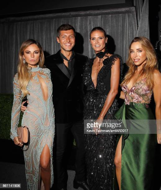 Erica Pelosini Heidi Klum and Katia Francesconi attend amfAR Los Angeles 2017 at Ron Burkle's Green Acres Estate on October 13 2017 in Beverly Hills...