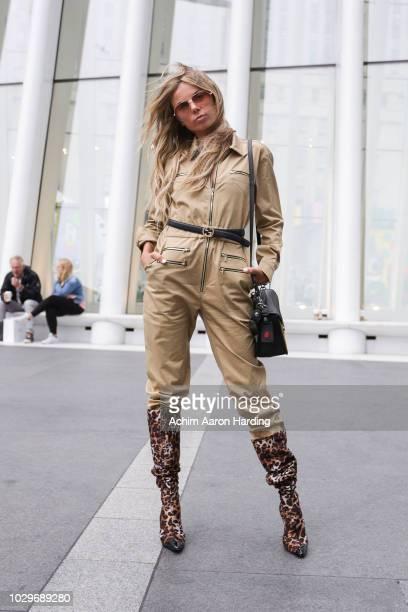 Erica Pelosini is seen wearing a Long Champ onepiece a Gucci belt a black second skin purse leopard print Giuseppe Zanotti boots and Tom Ford...
