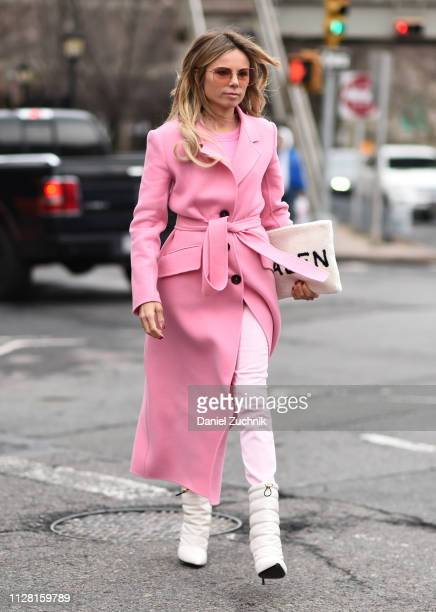 Erica Pelosini is seen wearing a pink coat and white boots outside the Tadashi Shoji show during New York Fashion Week Women's Fall/Winter 2019 on...