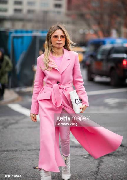 Erica Pelosini is seen wearing pink coat outside Tadashi Shoji during New York Fashion Week Autumn Winter 2019 on February 07 2019 in New York City
