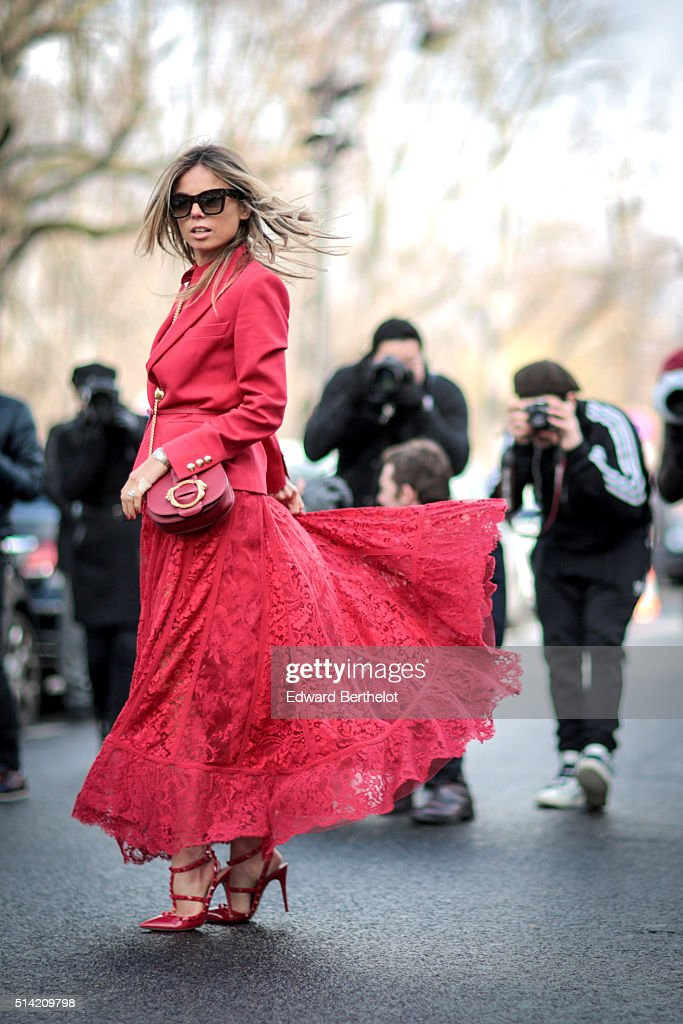 Erica Pelosini is wearing a red dress, after the Giambattista Valli show, during Paris Fashion Week, Womenswear Fall Winter 2016/2017, on March 7, 2016 in Paris, France.
