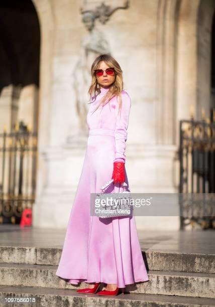 Erica Pelosini Leeman is seen wearing pink dress, Valentino bag, red gloves outside Schiaparelli during Paris Fashion Week - Haute Couture Spring...