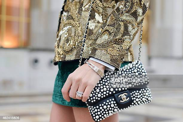 Erica Pelosini poses wearing Balmain jacket and Chanel bag during day 3 of Paris Haute Couture Spring Summer 2015 on January 28 2015 in Paris France