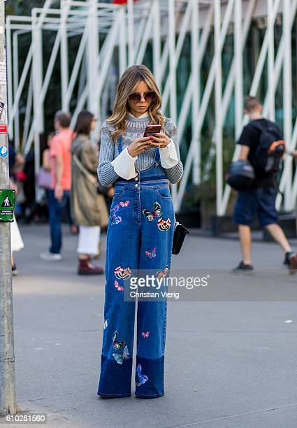 Erica Pelosini wearing a denim overall with patches outside Jil Sander during Milan Fashion Week Spring/Summer 2017 on September 24 2016 in Milan...