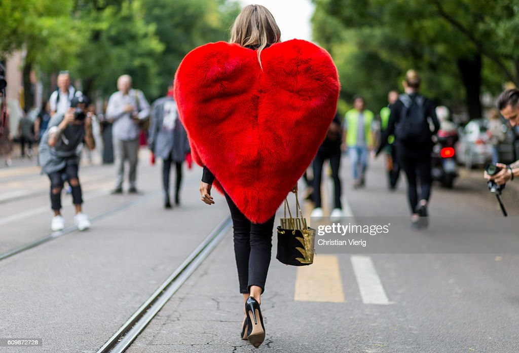Erica Pelosini wearing a heart jacket outside Fendi during Milan Fashion Week Spring/Summer 2017 on September 22, 2016 in Milan, Italy.