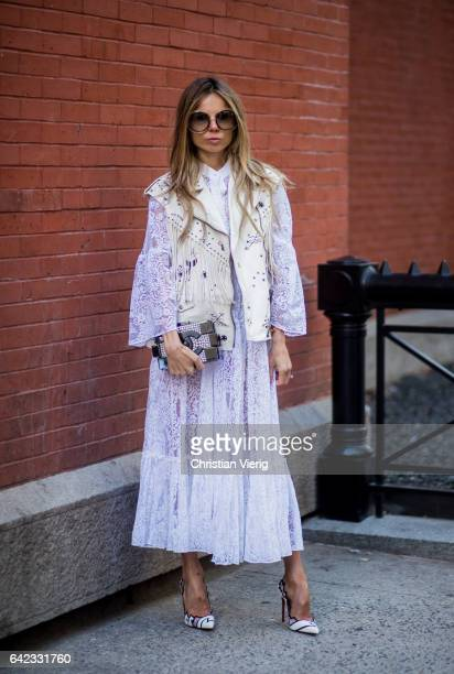 Erica Pelosini wearing a laced sheer dress with vest outside Marc Jacobs on February 16 2017 in New York City