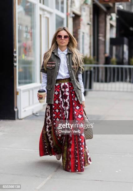 Erica Pelosini wearing a military jacket skirt Gucci bag outside Tory Burch on February 14 2017 in New York City