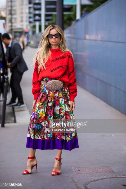 Erica Pelosini wearing a red Balenciaga jumper printed long skirt red heels and nude Gucci fanny pack is seen before the Giambattista Valli show on...