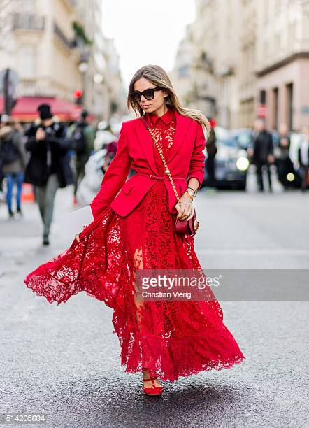 Erica Pelosini wearing a red lace dress from Giambattista Valli and blazer outside Giambattista Valli during the Paris Fashion Week Womenswear...
