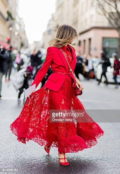 Erica Pelosini wearing a red lace dress from Giambattista Valli and blazer outside Giambattista Valli during the Paris Fashion Week Womenswear...