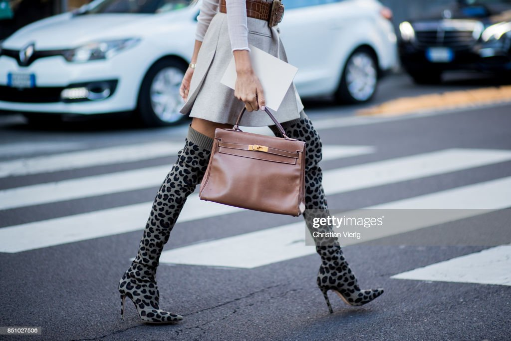 Erica Pelosini wearing belted blazer, overknee boots is seen outside Max Mara during Milan Fashion Week Spring/Summer 2018 on September 21, 2017 in Milan, Italy.