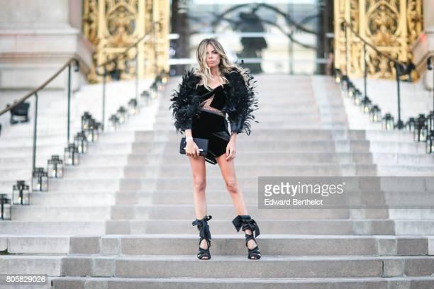 Erica Pelosini wears a black dress with fur outside the amfAR dinner at Petit Palais during Paris Fashion Week Haute Couture Fall/Winter 20172018 on...