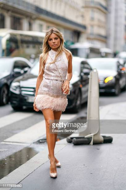 Erica Pelosini wears a sleeveless shiny glitter sequined dress with fringes pointy shoes a bag outside Ralph Russo during Paris Fashion Week...