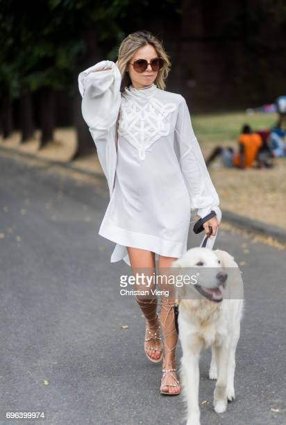 Erica Pelosini with her dog wearing gladiator sandals white dress is seen during Pitti Immagine Uomo 92 at Fortezza Da Basso on June 15 2017 in...