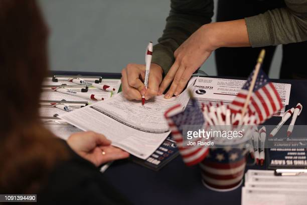 Erica Racz fills out her paperwork as she registers to vote at the Lee County Supervisor of Elections office on January 08 2019 in Fort Myers Florida...