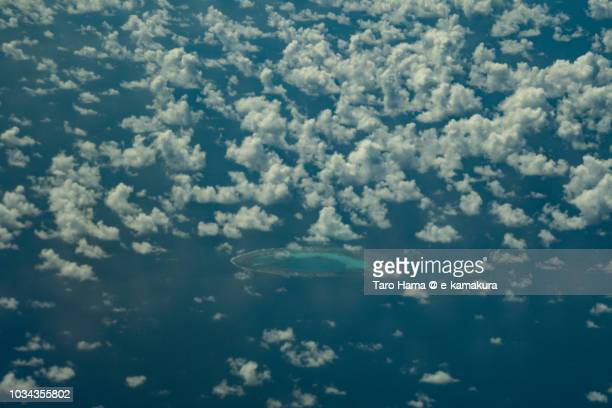 Erica Reef in Spratly Island in South China Sea daytime aerial view from airplane