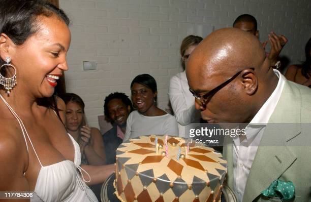 Erica Reid with Antonio 'LA' Reid as he blows out candles on his birthday cake