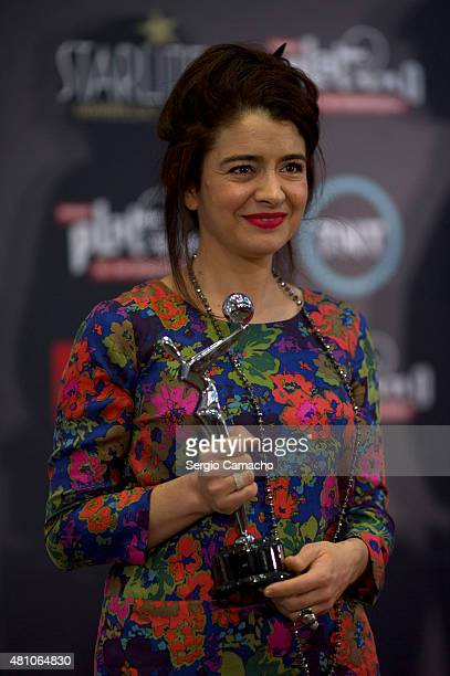 Erica Rivas an Argentinian actress poses with the Public Award after the TNTLA Platino Awards 2015 press conference at Hotel Los Monteros on July 17...