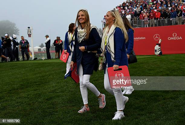 Erica Stoll and Caroline Harrington walk off the first tee during morning foursome matches of the 2016 Ryder Cup at Hazeltine National Golf Club on...