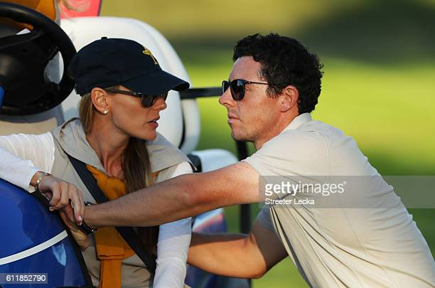 Erica Stoll and Rory McIlroy of Europe look on during afternoon fourball matches of the 2016 Ryder Cup at Hazeltine National Golf Club on October 1...
