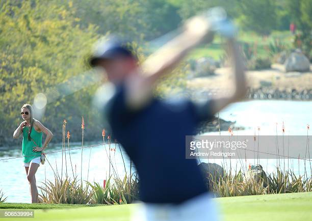 Erica Stoll fiancee of Rory McIlroy of Northern Ireland watches him on the 14th hole during round four of the Abu Dhabi HSBC Golf Championship at the...