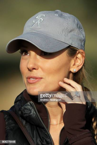 Erica Stoll wife of Rory McIlroy of Northern Ireland looks on during round one of the Abu Dhabi HSBC Golf Championship at Abu Dhabi Golf Club on...