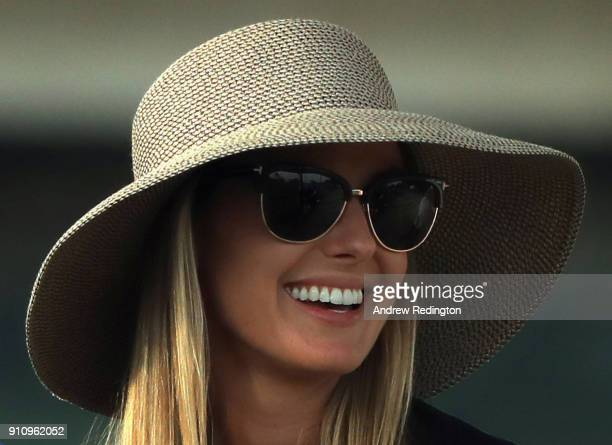 Erica Stoll wife of Rory McIlroy of Northern Ireland looks on during the third round of the Omega Dubai Desert Classic at Emirates Golf Club on...