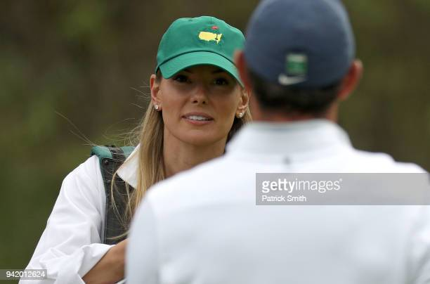 Erica Stoll wife of Rory McIlroy of Northern Ireland looks on during the Par 3 Contest prior to the start of the 2018 Masters Tournament at Augusta...