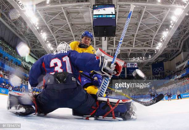 Erica Uden Johansson of Sweden scores a goal in the first period against So Jung Shin of Korea during the Women's Ice Hockey Preliminary Round -...
