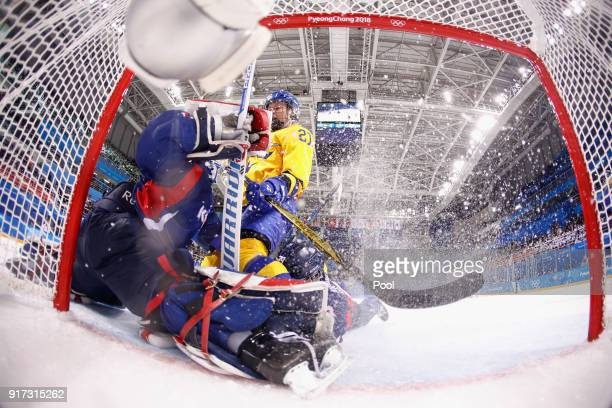 Erica Uden Johansson of Sweden scores a goal in the first period against So Jung Shin of Korea during the Women's Ice Hockey Preliminary Round Group...