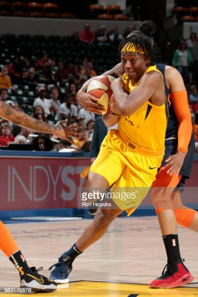 Erica Wheeler of the Indiana Fever handles the ball against the Connecticut Sun during a WNBA game on June 24 2018 at Bankers Life Fieldhouse in...