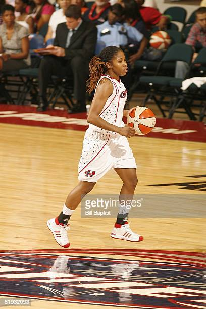 Erica White of the Houston Comets moves the ball against the Indiana Fever during the game at Reliant Arena on June 28, 2008 in Houston, Texas. The...