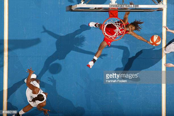 Erica White of the Phoenix Mercury rebounds against the Minnesota Lynx on June 21 2008 at the Target Center in Minneapolis Minnesota NOTE TO USER...
