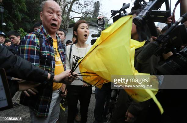 Erica Yuen Mi-ming of People Power and members protest at Government House during the Government House annual open day. 15MAR15