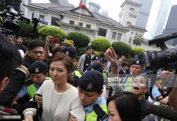 Erica Yuen Mi-ming of People Power arrested by police during the Government House annual open day. 15MAR15
