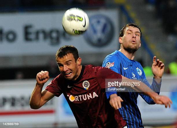 Erich Brabec of AC Sparta Praha heads the ball clear from Michael Rabusic of FC Slovan Liberec during the Czech Gambrinus Liga match between FC...