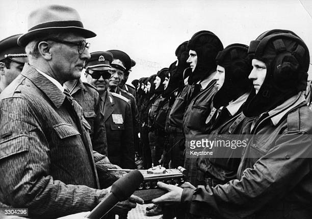 Erich Honecker the East German Communist President presents a 'Golden Tank' award following Warsaw Pact Manoeuvres
