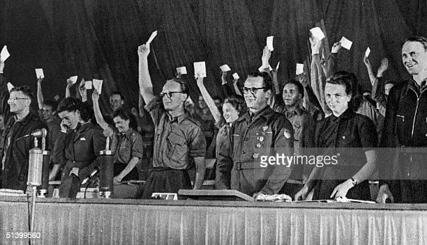 Erich Honecker the first chairman of the East German communist youth organization Free German Youth smiles as his fellow comrades vote his reelection...