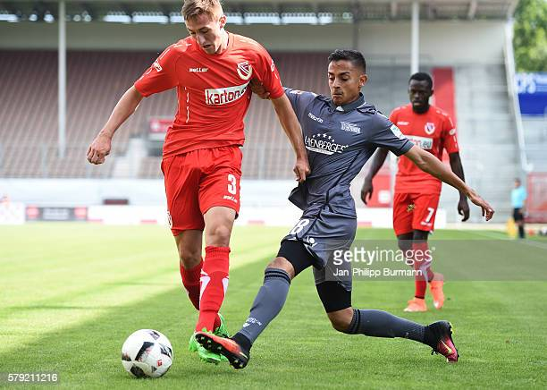 Erich Jeschke of FC Energie Cottbus and Kenny Prince Redondo of 1 FC Union Berlin during the test match between FC Energie Cottbus and 1 FC Union...