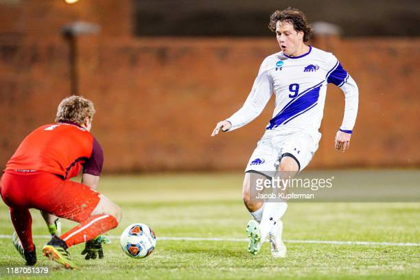 Erich Kindermann of Tufts Jumbos beats out German Giammattei of Amherst Mammoths to the ball during the Division III Men's Soccer Championship held...
