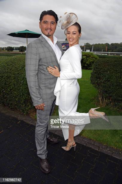 Erich Klann and his girlfriend Oana Nechiti attend the Audi Ascot Race Day at Neue Bult horse racing track on August 18 2019 in Langenhagen Germany