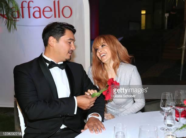 Erich Klann and his wife Oana Nechiti during the Raffaello Summer Dinner at Koenigliche Porzellan Manufaktur on August 27, 2020 in Berlin, Germany.