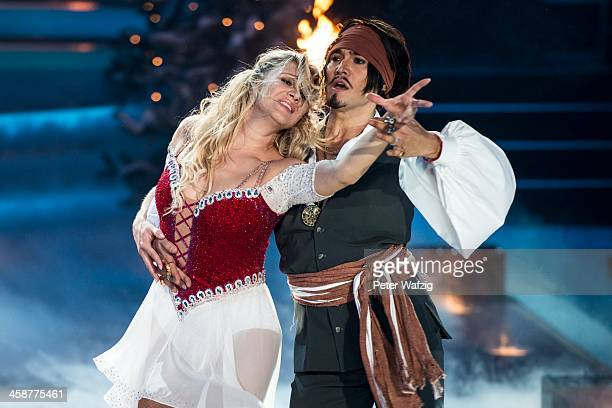 Erich Klann and Magdalena Brzeska perform during the Final of 'Let's Dance - Let's Christmas' TV Show on December 21, 2013 in Cologne, Germany.
