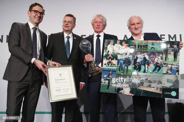 Erich Rutemoeller poses with DFB Secretary General Friedrich Curtius DFB President Reinhard Grindel and Rudi Voeller after receiving the lifetime...