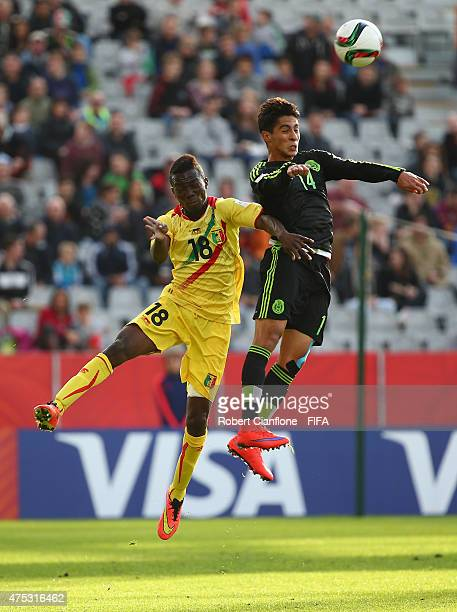 Erick Aguirre of Mexico heads the ball in front of Dieudonne Gbakle of Mali during the FIFA U-20 World Cup New Zealand 2015 Group D match between...