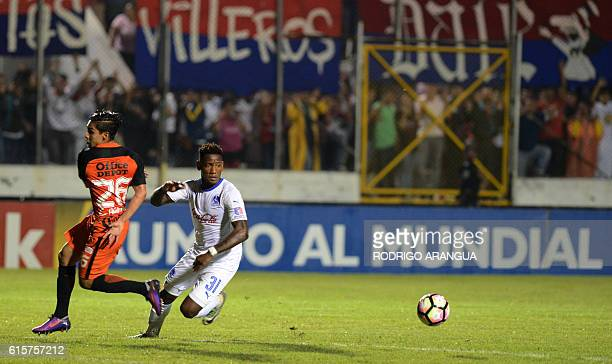 Erick Aguirre of Mexico's Pachuca vies for the ball with Romell Quioto of Honduras' Olimpia during their CONCACAF Champions League football match at...
