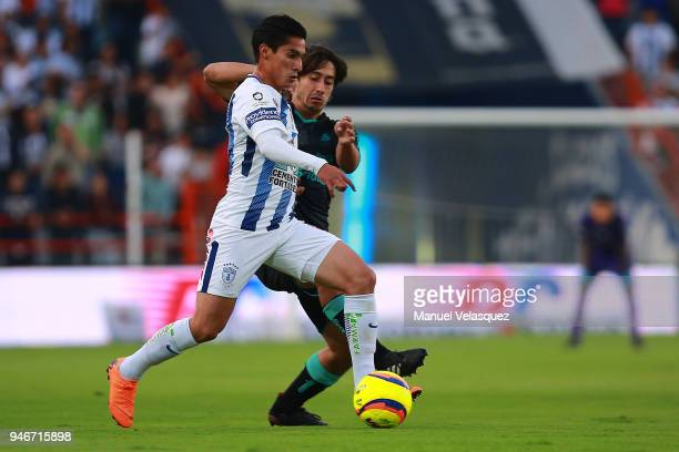 Erick Aguirre of Pachuca struggles for the ball against Jose Abella of Santos during the 15th round match between Pachuca and Santos Laguna as part...